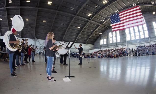 The James Monroe Middle School Chargers Band from Tampa, Fla. plays a song during the Science, Technology, Engineering, Arts and Math (STEAM) Day at MacDill Air Force Base, Fla., March 21, 2018.  The Monroe Chargers Band represented the arts during the MacDill STEAM Day event. (U.S. Air Force photo by Airman 1st Class Scott Warner)