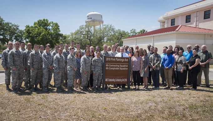 U.S. Air Force Airmen assigned to the 6th Contracting Squadron (CONS) pause for a photo at MacDill Air Force Base, Fla., April 3, 2018. The 6th CONS won the Air Force Small Business Director's Beyond Goals Award for 2017, which was a result of spending $185.5 million with local small business during the fiscal year. (U.S. Air Force photo by Airman 1st Class Scott Warner)
