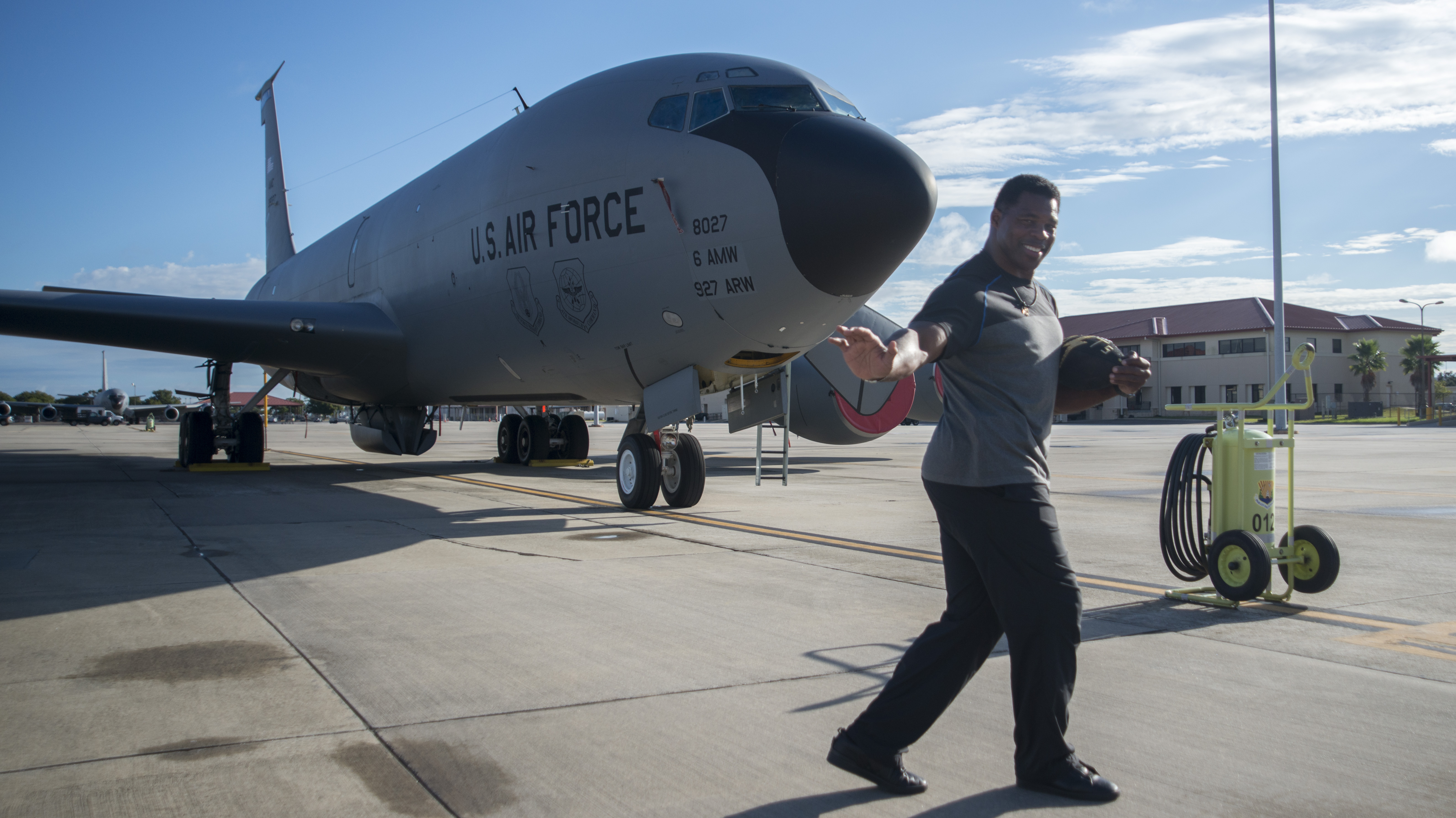 Former NFL running back Herschel Walker pauses for a photo in front of a KC-135 Stratotanker at MacDill Air Force Base, Fla., Nov. 15, 2018. Walker visited MacDill for two days, touring facilities and speaking to Airmen about resiliency and mental health. (U.S. Air Force photo by Airman 1st Class Ryan C. Grossklag)
