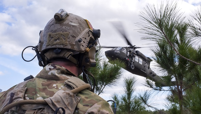 A U.S. Navy Sea, Air and Land (SEAL) team member awaits extraction from a UH-60 Black Hawk helicopter during an Emerald Warrior 2019 search and rescue training exercise, Jan. 22, 2019. Special Tactical Operation SEALs worked alongside joint terminal attack controllers to extract injured and embattled joint force team members in an austere environment. (U.S. Air Force photo by Airman 1st Class Scott Warner)