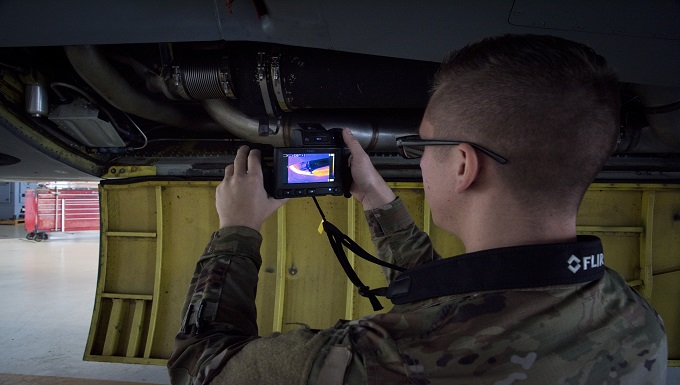 U.S. Air Force Staff Sgt. James Morin, a 6th Aircraft Maintenance Squadron electrical and environmental systems craftsman, takes a thermal image of a bleed air duct at MacDill Air Force Base, Fla., March 1, 2019. As part of the wing's 'Fuel Tank' innovation program, thermal imaging cameras have been approved and implemented recently to quickly determine faulty parts based on inconsistent heat signatures on a KC-135 Stratotanker. Morin is one of five thermography certified technicians at MacDill. (U.S. Air Force photo by Airman 1st Class Scott Warner)