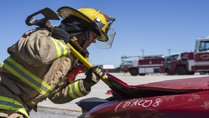 A Wyoming Air National Guard firefighter from the 153rd Airlift Wing in Cheyenne, Wyoming, pries open the hood of a car during a joint exercise with Airmen from the 6th Civil Engineer Squadron at MacDill Air Force Base, Fla., March 6, 2019. The training included rappelling and technical rescue skills, fire ground tactics, fire suppression, live-fire drills, vehicular extraction and aircraft familiarization. (U.S. Air Force photo by Airman 1st Class Scott Warner)