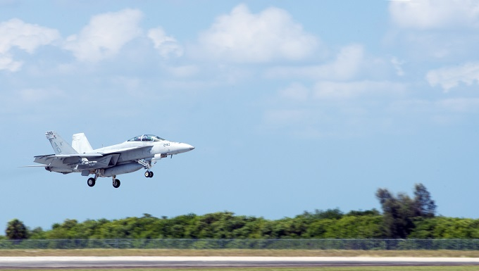 A U.S. Navy Strike Fighter Squadron 106 F/A-18F Super Hornet aircraft from Naval Air Station Oceania, Va., lands at MacDill Air Force Base, Fla., Oct. 1, 2019. Eighteen F/A-18F Super Hornet aircraft, 18 pilots, 30 instructors and many more aviation mechanics and electricians from NAS Oceania train at MacDill with base Airmen providing logistical support behind-the-scenes. (U.S. Air Force photo by Senior Airman Scott Warner)