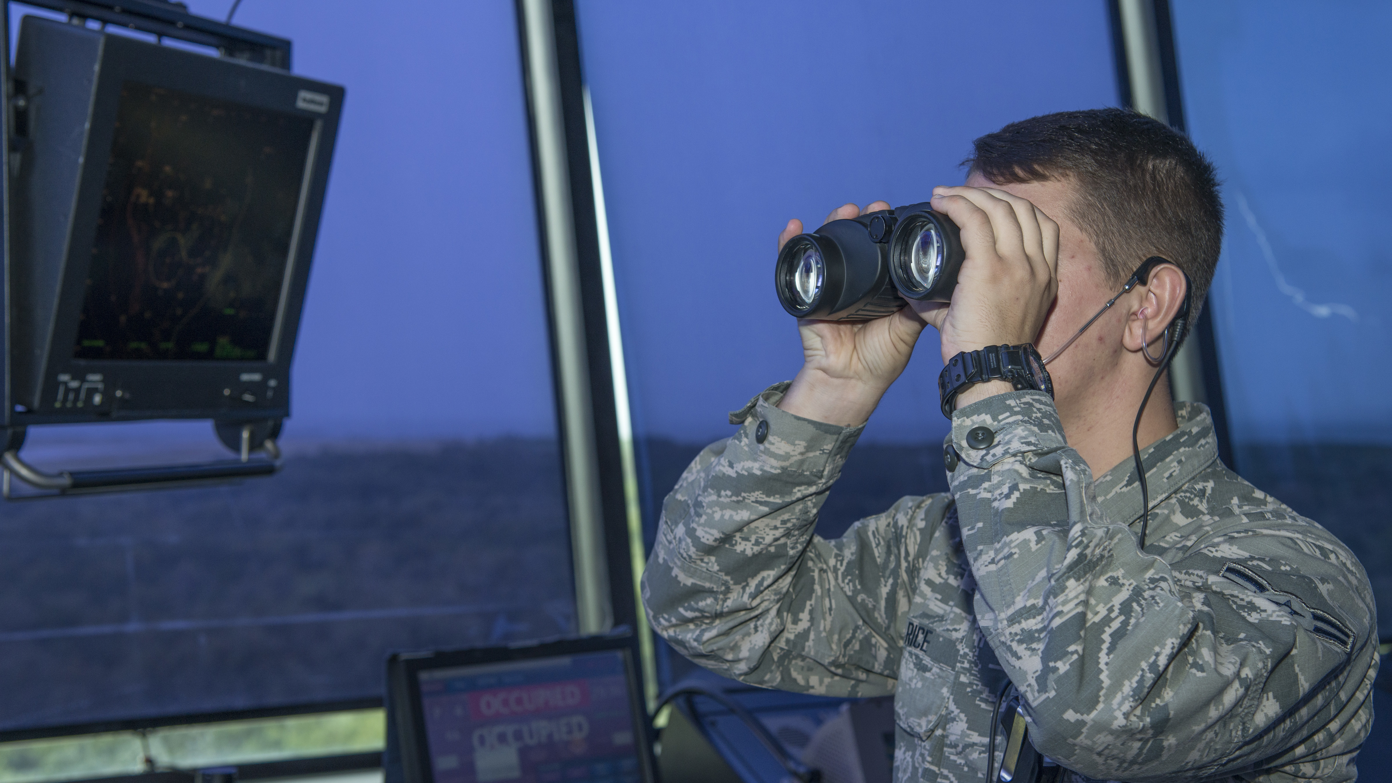 Airman 1st Class Samson Rice, a 6th Operations Support Squadron air traffic control apprentice, checks for incoming aircraft at MacDill Air Force Base, Fla., Oct. 9, 2019. Air traffic controllers track aircraft while communicating with pilots to ensure successful aircraft launch and recovery. (U.S. Air Force photo by Airman 1st Class Ryan C. Grossklag)