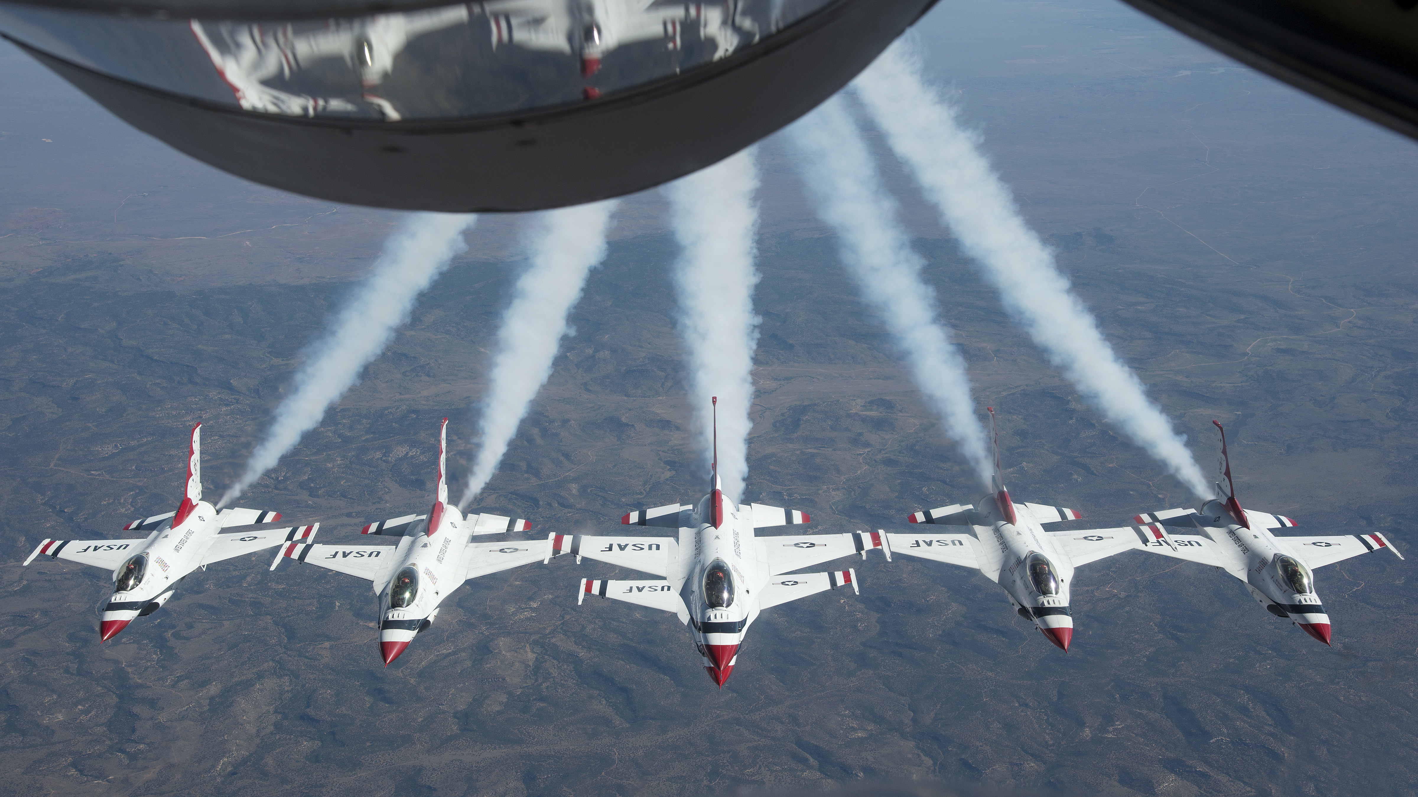 """The United States Air Force Air Demonstration Squadron """"Thunderbirds"""" fly in formation after being refueled by the 50th Air Refueling Squadron from MacDill Air Force Base, Fla., Oct. 14, 2019. The Thunderbirds are a flying aerobatic team that performs at air shows around the world. (U.S. Air Force photo by Airman 1st Class Ryan C. Grossklag)"""