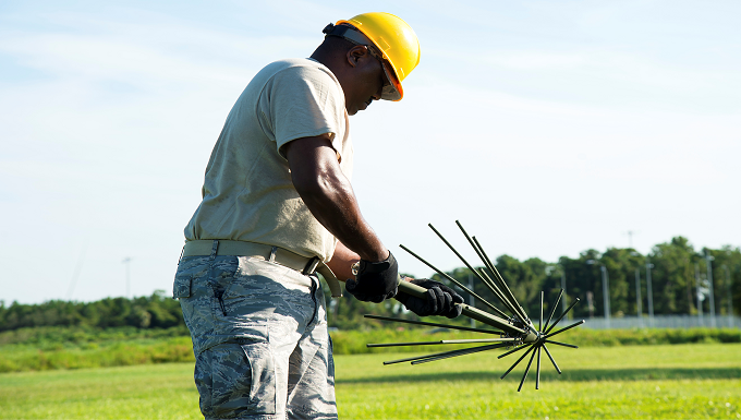U.S. Air Force Staff Sgt. Jeramiah Nicholson, a 193rd Special Operations Communication Squadron radio frequency transmissions technician, sets up a tactical antenna system, July 18, 2019, at MacDill Air Force Base, Fla. Air Force Special Operations Command conducted a two- week Total Force training exercise at MacDill to test the mission readiness and capabilities of SOCS personnel. (U.S. Air Force photo by Airman 1st Class Shannon Bowman)