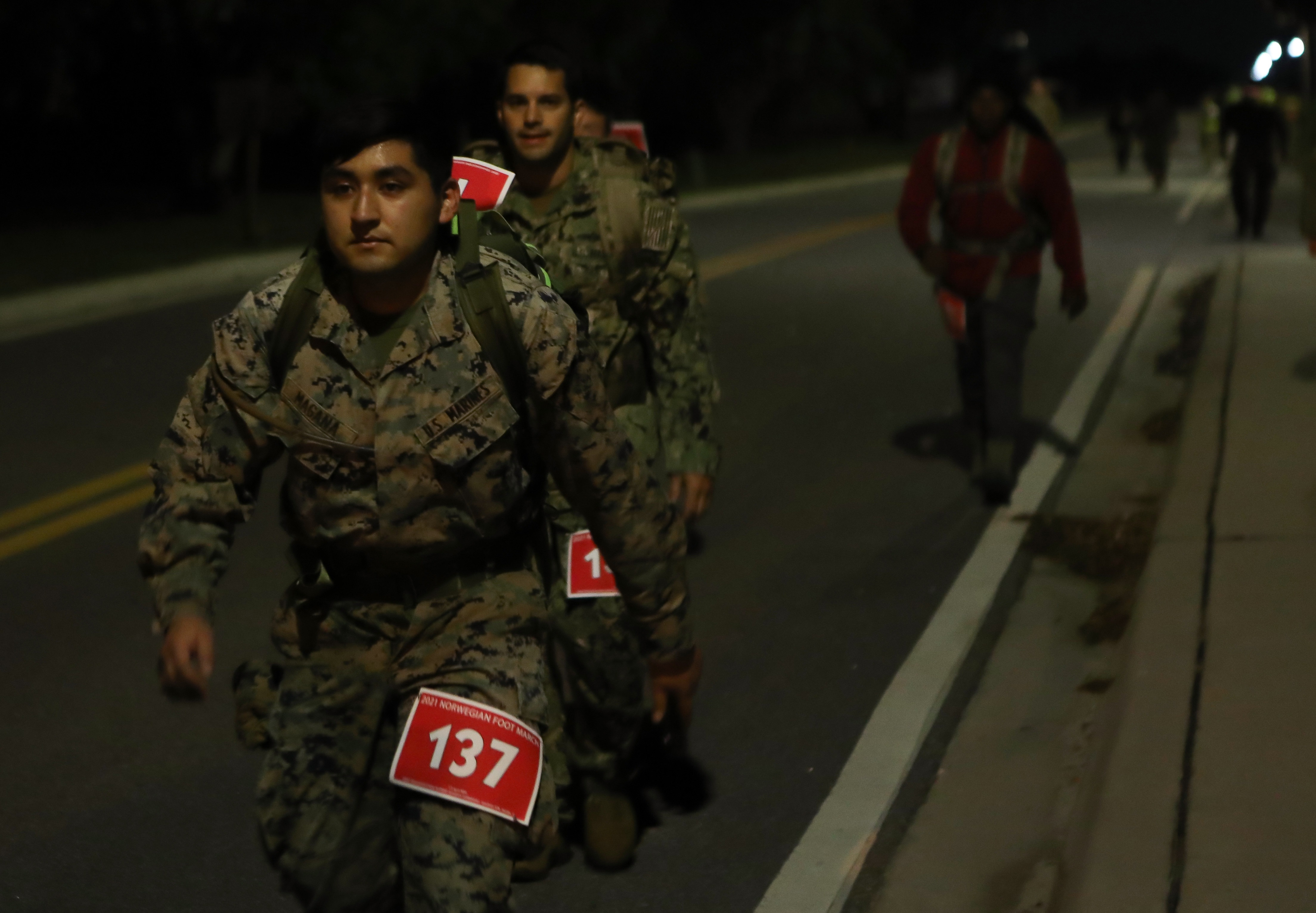 Joint service personnel from U.S. Central Command headquarters and other base commands take part in an early morning Norwegian Foot March at MacDill Air Force Base, April 2, 2021.
