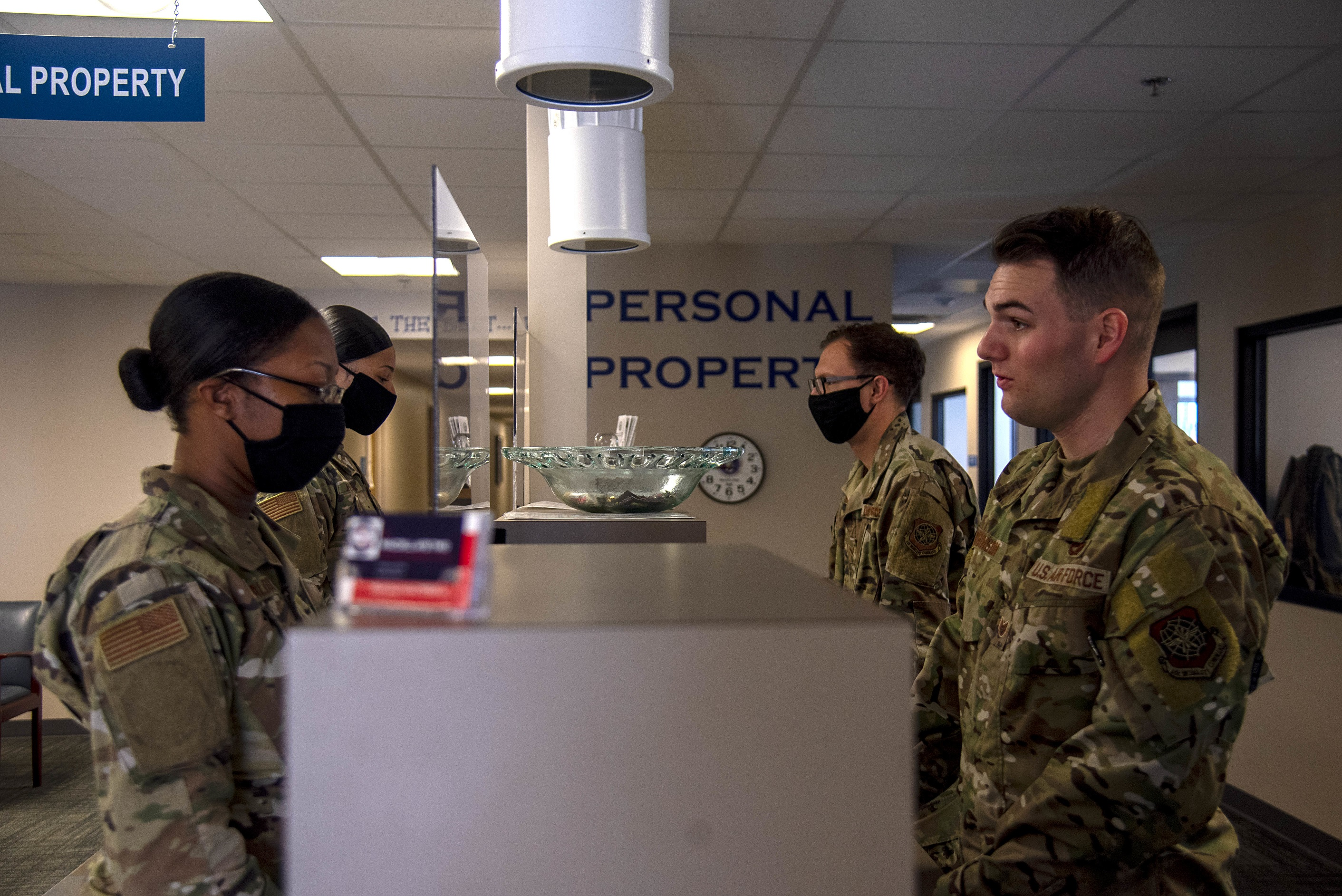 A U.S. Air Force Airmen receives a briefing about the 6th Logistics Readiness Squadron (LRS) Traffic Management Office (TMO) personal property office's responsibilities at MacDill Air Force Base, Florida, May 26, 2021.