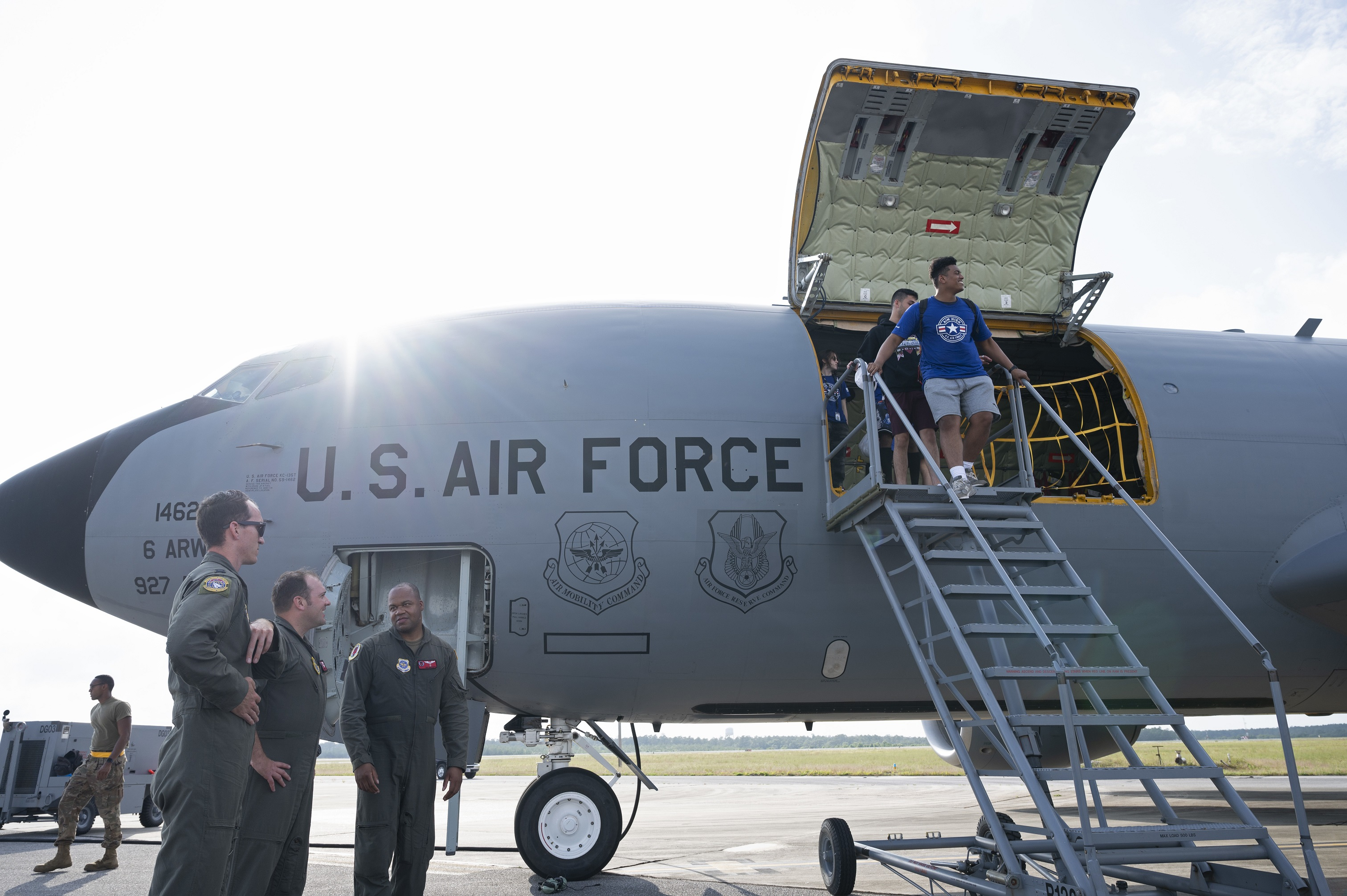 AIM HIGH Flight Academy students exit a 6th Air Refueling Wing KC-135 Stratotanker after a flight at Eglin Air Force Base, Florida, June 7, 2021.