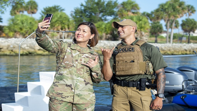 Chief Master Sgt. of the Air Force JoAnne S. Bass poses for a photo with U.S. Air Force Staff Sgt. William Au, a 6th Security Forces Squadron (SFS) marine patrolman, at MacDill Air Force Base, June 10, 2021. Bass spent time answering questions and getting to know members of the 6th SFS after running through a boating exercise. (U.S. Air Force photo by Airman 1st Class Joshua Hastings)